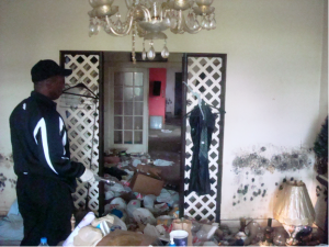 Clarence in his flooded home